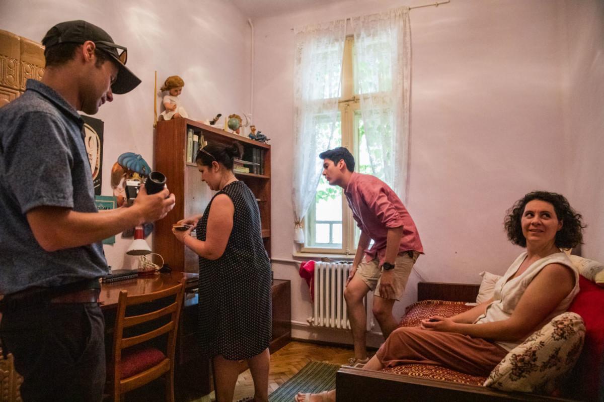 guests exploring authentic communist apartment