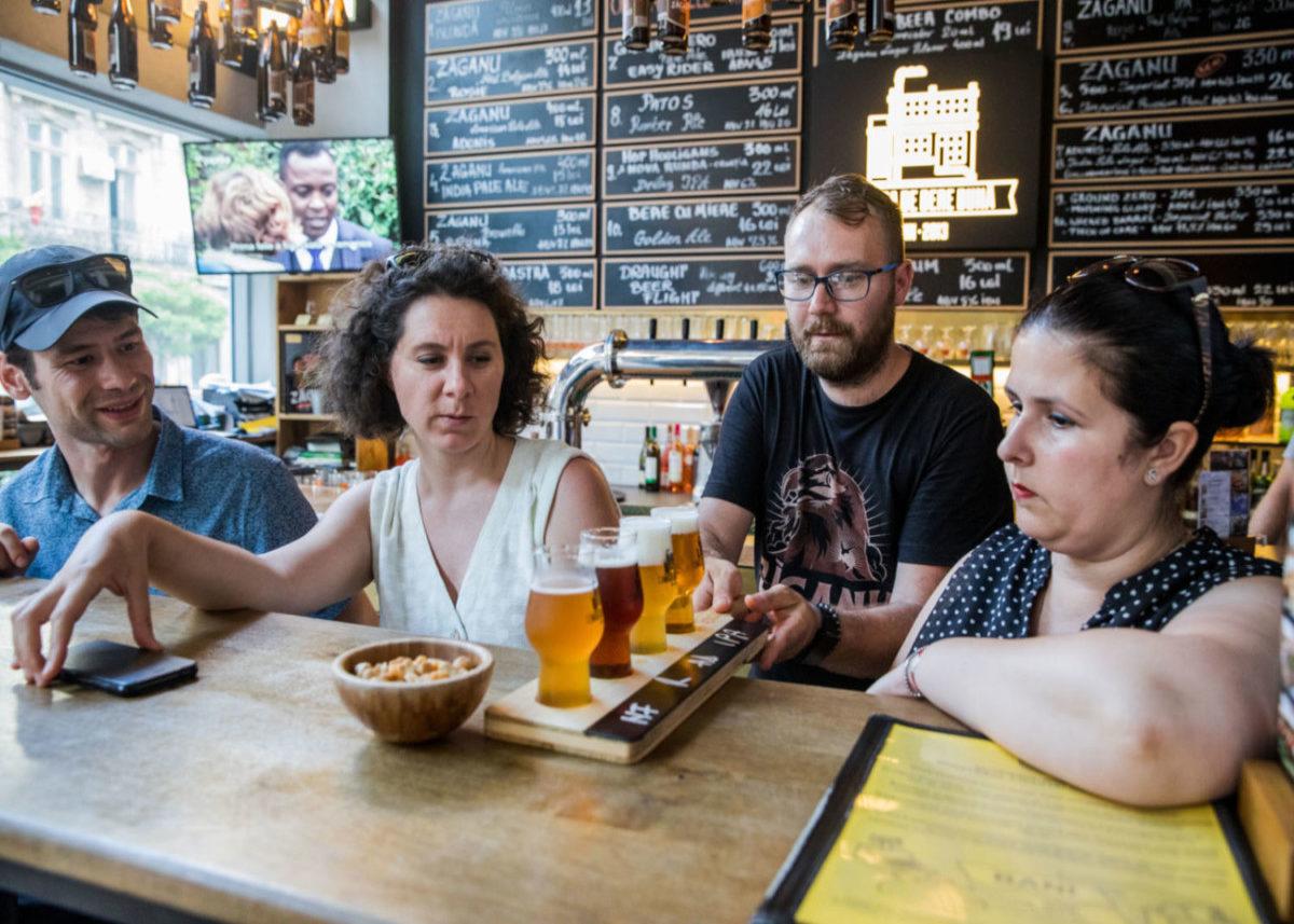 server bringing beer sampler to guests